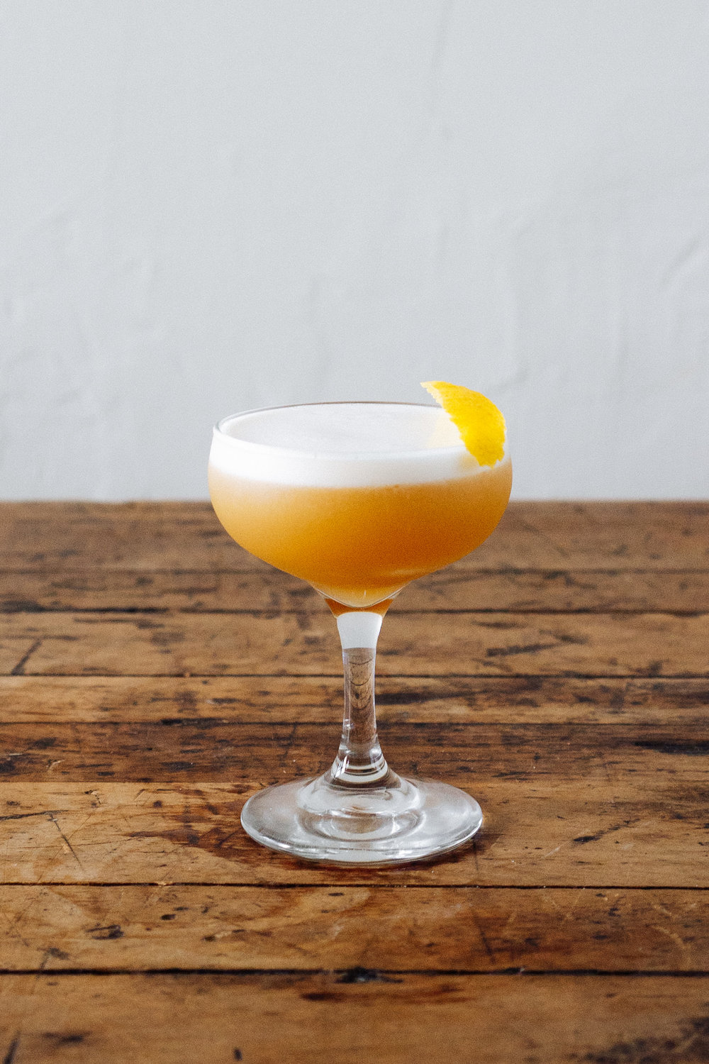 MARSHALL GOLD   1 1/2 oz Double Oak Bourbon  1/2 oz Chareau  3/4 oz Lemon Juice  1/2 oz Simple  1 Egg White  Build in tin, dry shake, wet shake, and double strain. Garnish with lemon peel.