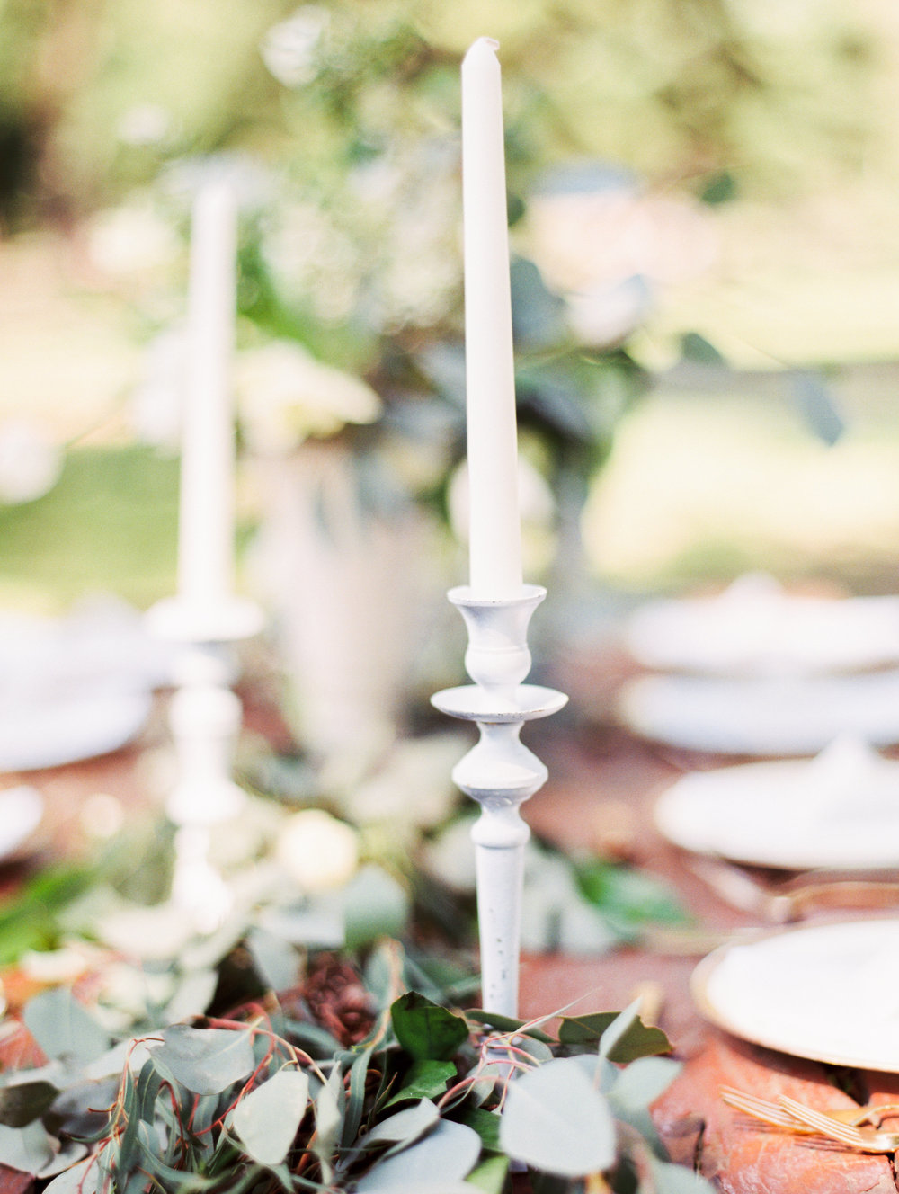 White Candlestick Centerpieces