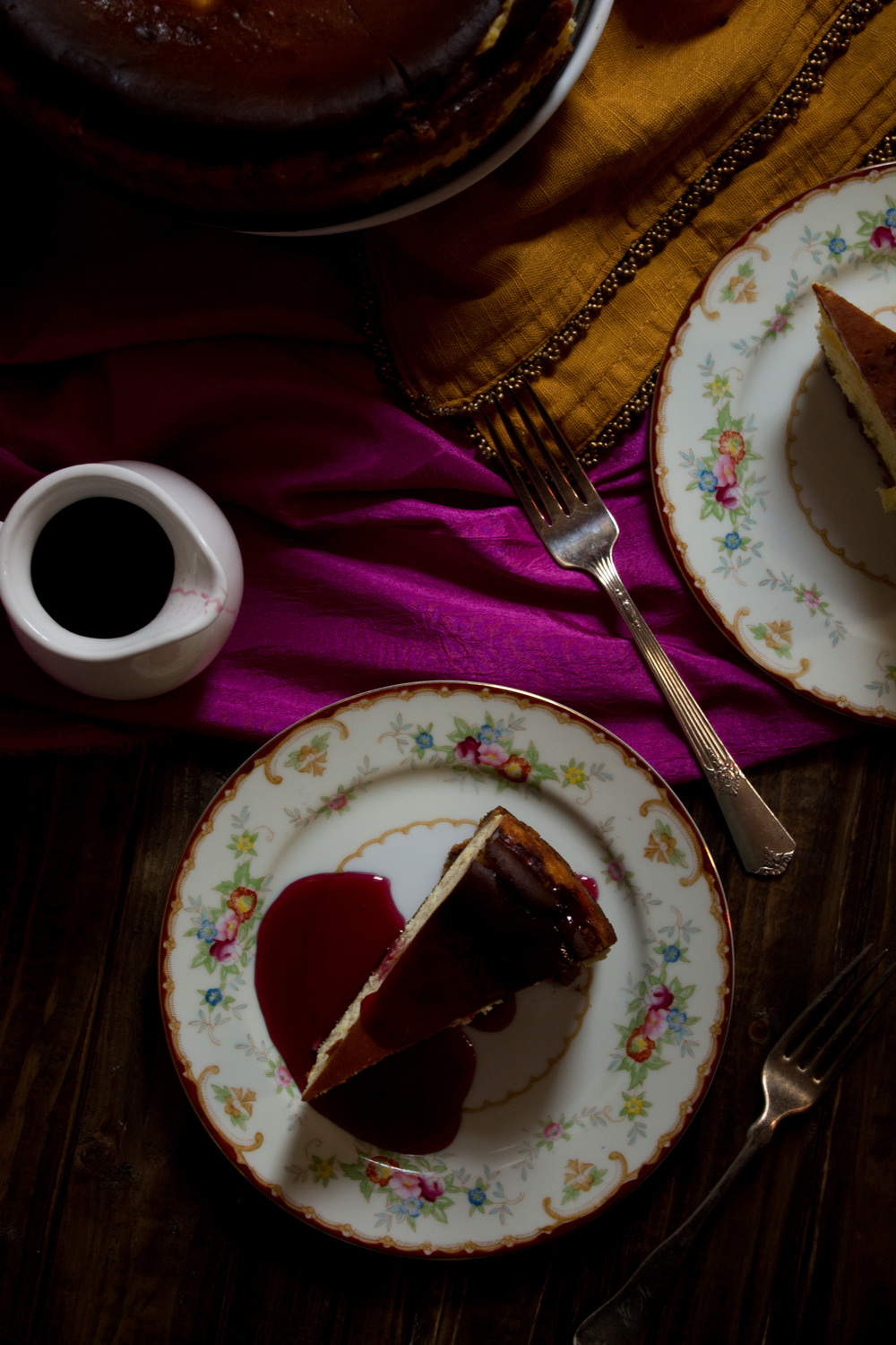 Vanilla Cheesecake with Cranberry Wine Sauce