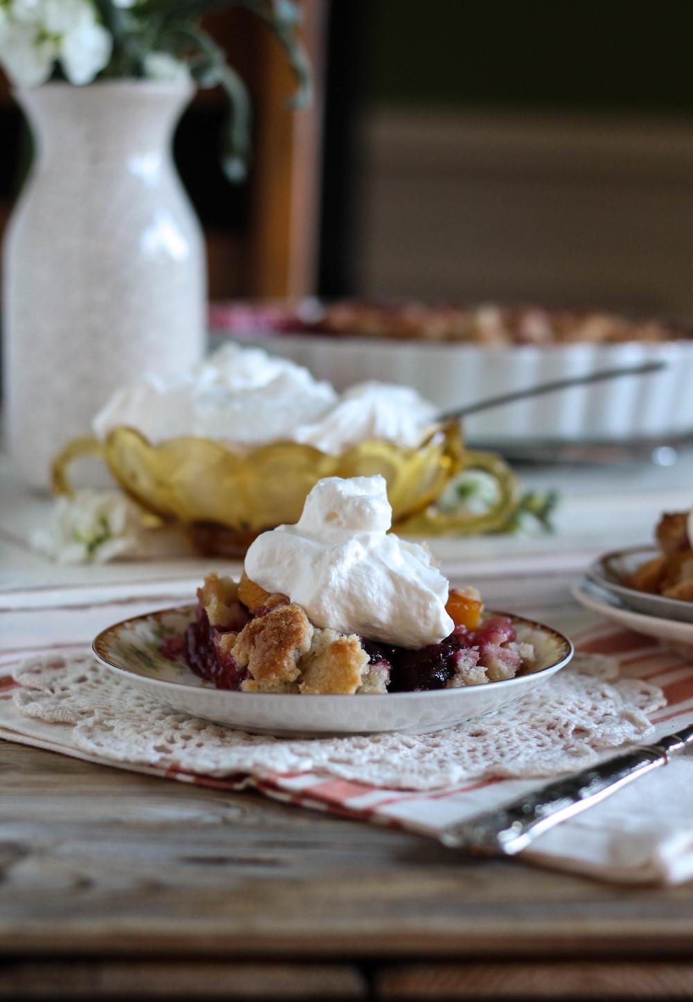 Peach & Cherry Cornmeal Cobbler with Rum Whipped Cream {Pedantic Foodie}