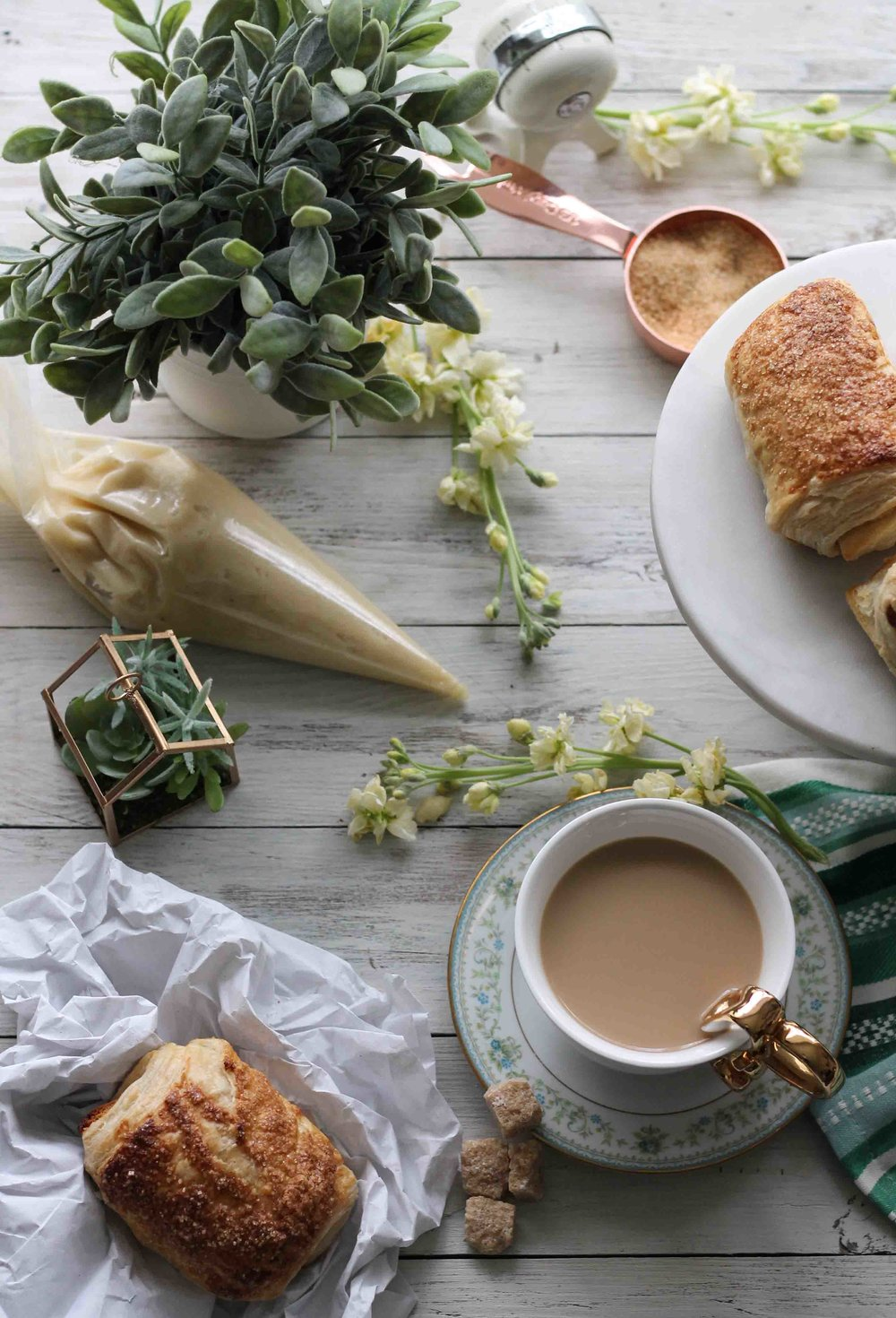 These decadent almond croissants are an endeavor to be sure, but they are worth every bit of effort.  With buttery, homemade puff pastry and a sweet homemade almond paste, these croissants make the perfect breakfast.