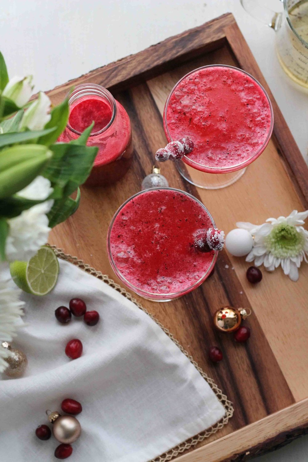 This gorgeous pink spritzer combines a rich, vanilla bean syrup, tart cranberries, and a twist of lime for a festive drink that is sure to make this holiday season memorable.  {pedanticfoodie.com}