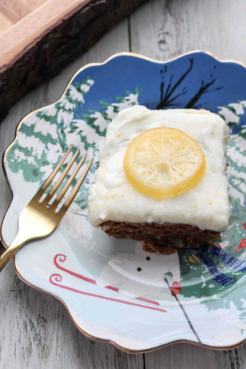 A deeply spicy gingerbread cake studded with candied lemon and crystalized ginger topped with a lemon cream cheese frosting makes is the perfect dessert for the holidays. [www.pedanticfoodie.com]