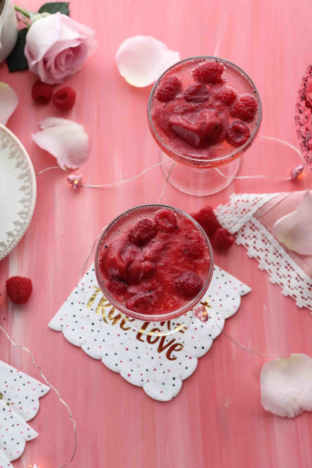 These adorably festive vanilla bean spritzers are the perfect romantic treat for you and your sweetheart this Valentine's Day.  These spritzers feature a vanilla bean syrup, sweet, raspberry sorbet and prosecco-soaked raspberries.  [ www.pedanticfoodie.com ]