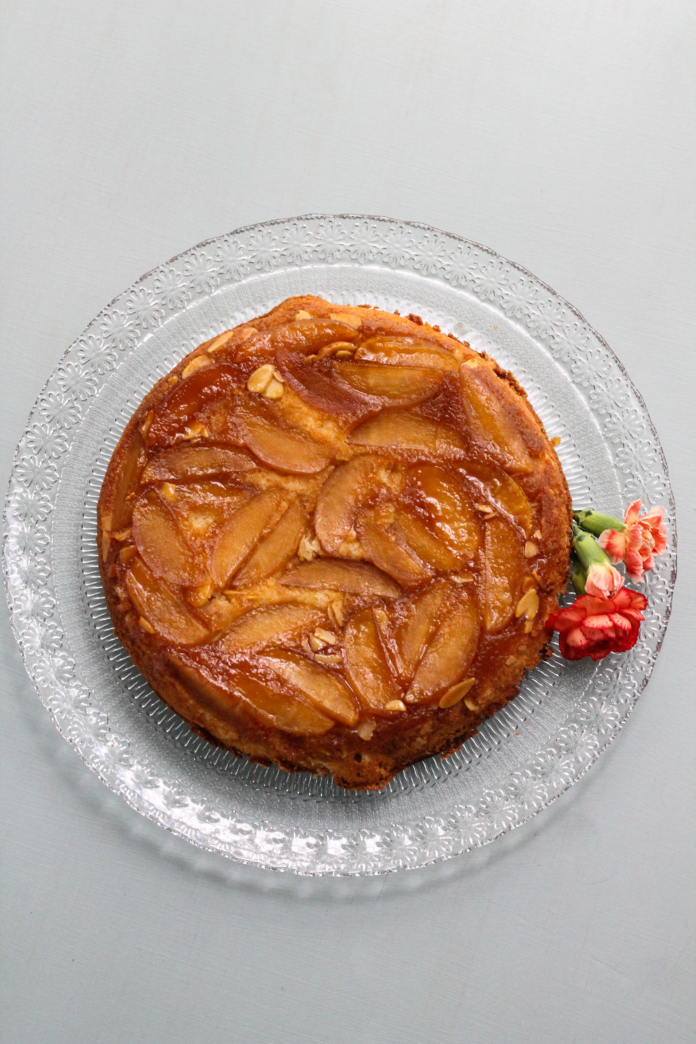 Caramelized apples in a cider glaze are covered with a soft, almond cake and then flipped to create this scrumptious Apple Amaretto Upside Down Cake! [ www.pedanticfoodie.com ]