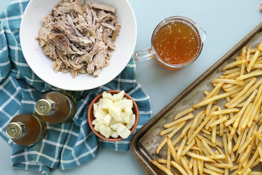 This ultra simple Slow Cooker Pork & Ale Poutine makes the perfect game day meal!! [ www.pedanticfoodie.com ]