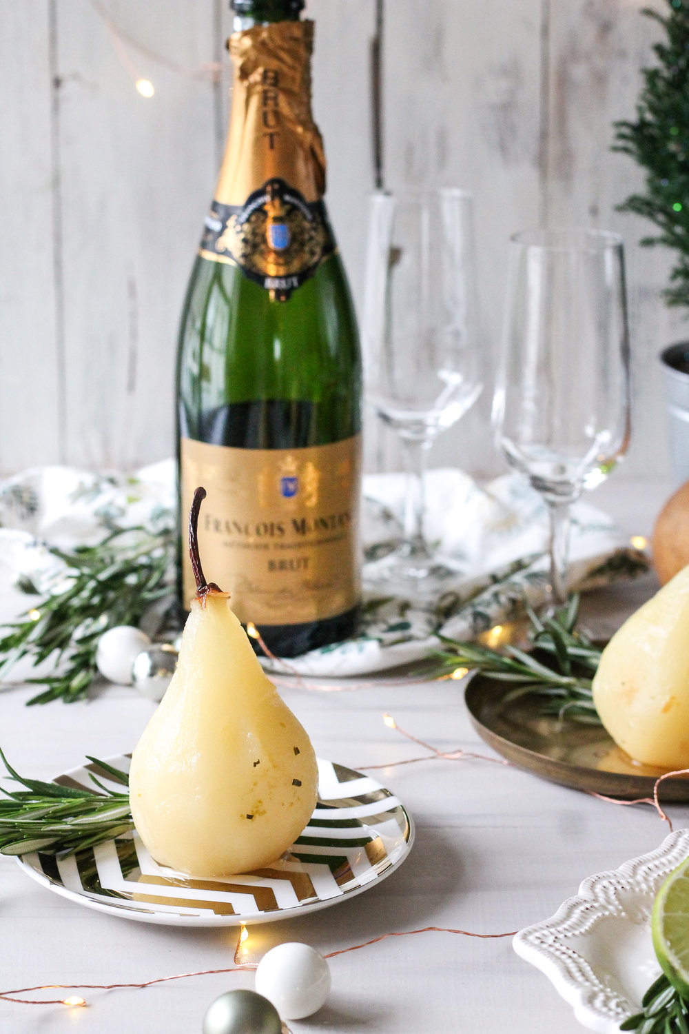 Champagne Poached Pears with Rosemary & Lime make the perfect New Year's Eve treat!  Find the super simple recipe on www.pedanticfoodie.com!!!