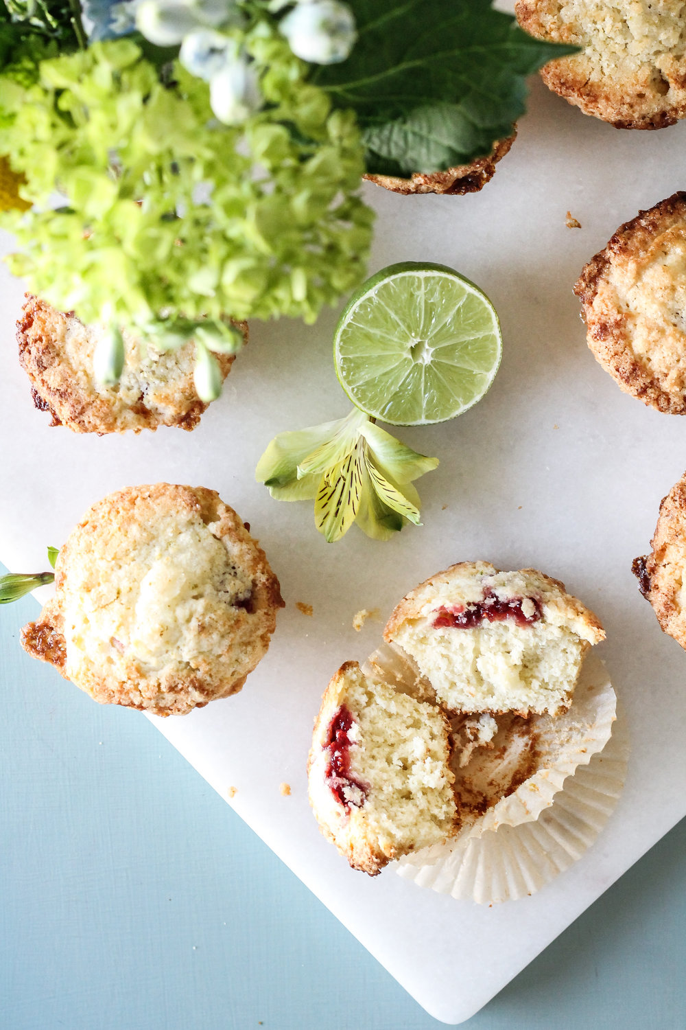 These tender Lime Sugar Streusel Muffins are filled with a tart layer of Raspberry Preserves and covered with a crisp, zesty streusel - a perfect way to start the day!  Find the recipe on www.pedanticfoodie.com!These tender Lime Sugar Streusel Muffins are filled with a tart layer of Raspberry Preserves and covered with a crisp, zesty streusel - a perfect way to start the day!  Find the recipe on www.pedanticfoodie.com!