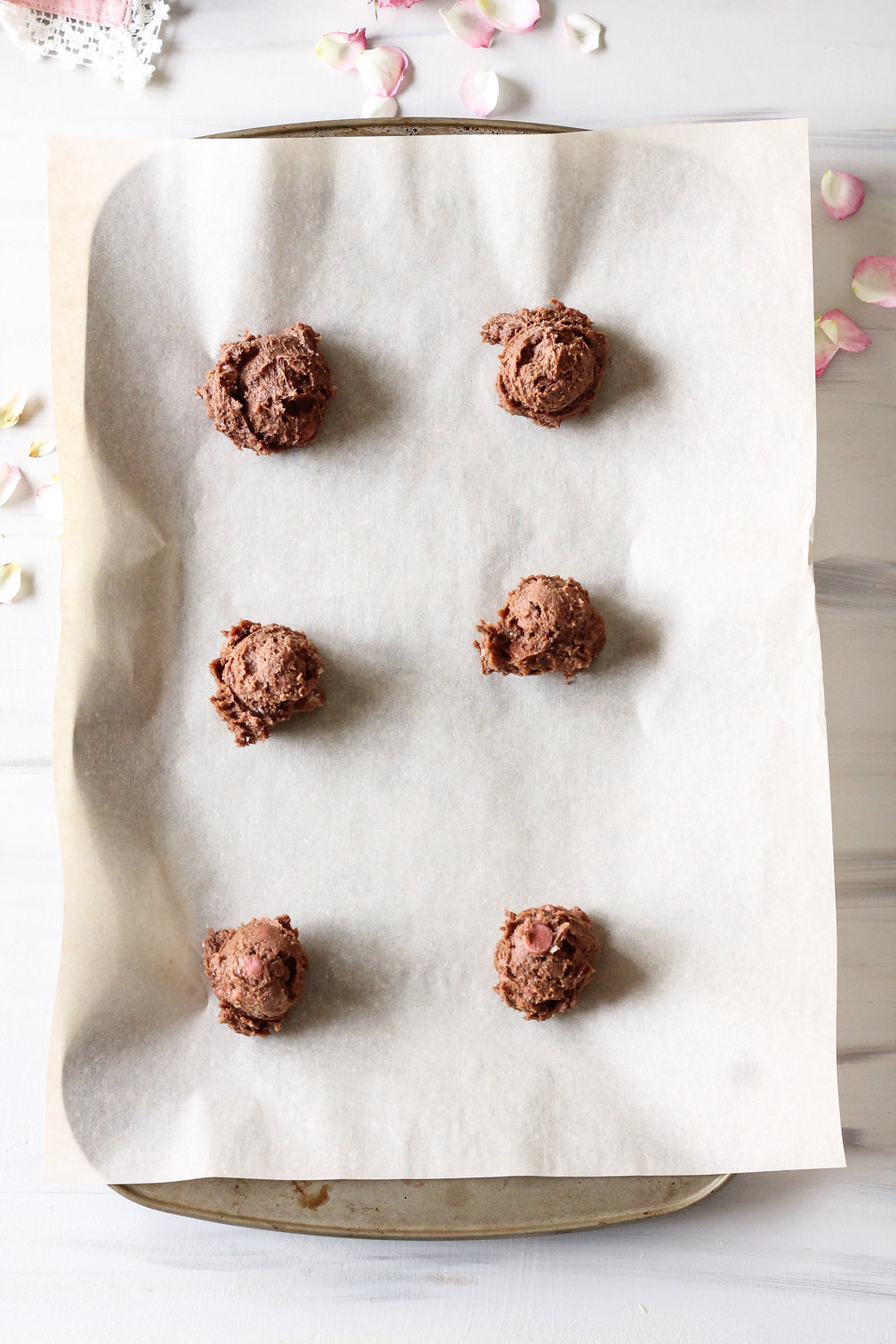 RUBY CHOCOLATE CHIP COOKIES!! These ultra crispy chocolate cookies are studded with the newest and most coveted kind of chocolate - ruby chocolate!  Find the super simple recipe on www.pedanticfoodie.com!