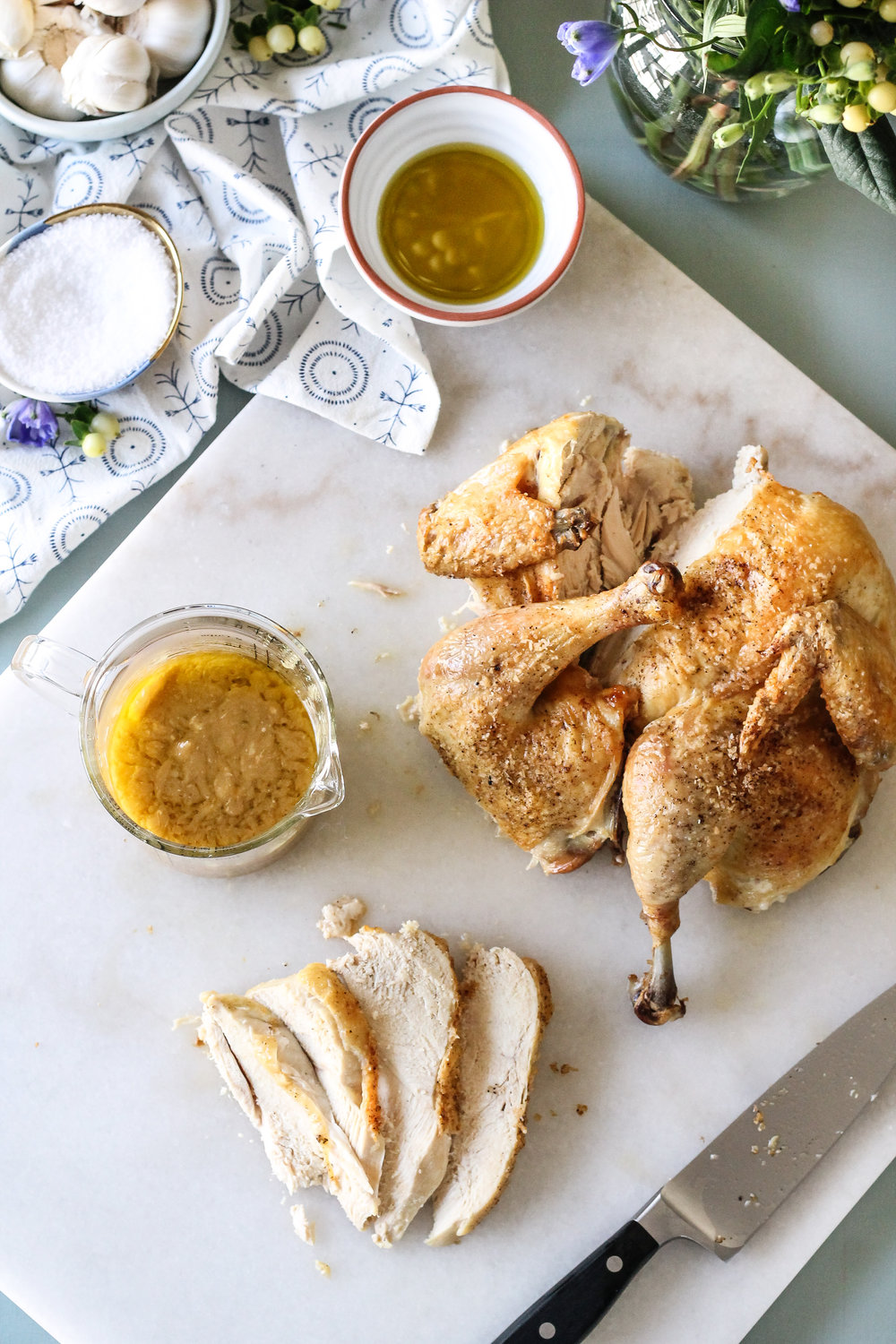 Spatchcocked Chicken with Bitter Lemon & Garlic is the perfect weeknight dinner when you need a bit of cozy!  Find the recipe on www.pedanticfoodie.com!