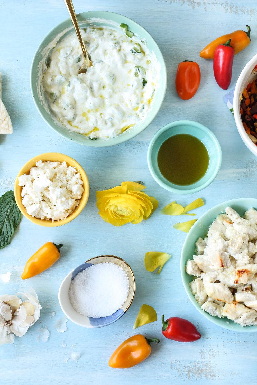 These fresh & simple Lemon & Yogurt Greek Chicken Bowls make the perfect weeknight dinner!  Find the recipe on WWW.PEDANTICFOODIE.COM.