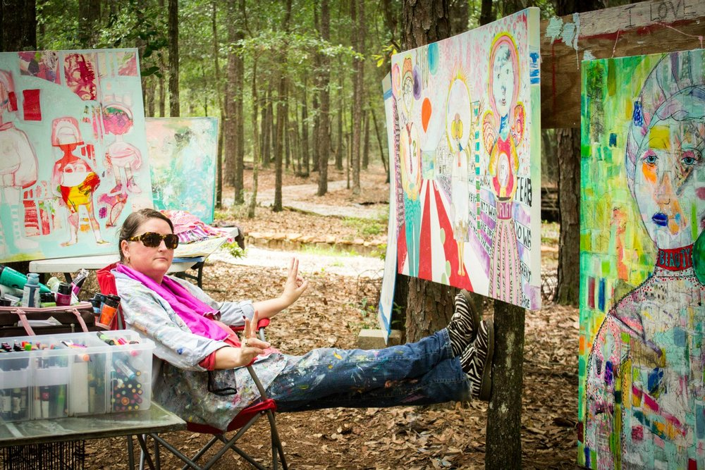 Having fun is a MUST in my world and here is a pic of me in my outdoor studio goofing off, loving a full paint day, and sending my most important message....peace. :)