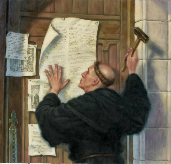 Martin Luther (1483-1546) nails his 95 theses to the door at Wittenburg University.