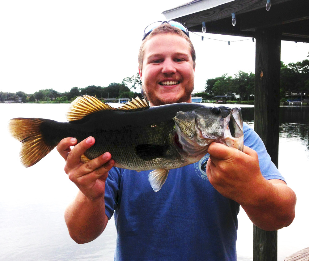 Author Trey Dyer with a nice bass caught on a chartreuse topwater popping fly in Orlando, Florida.