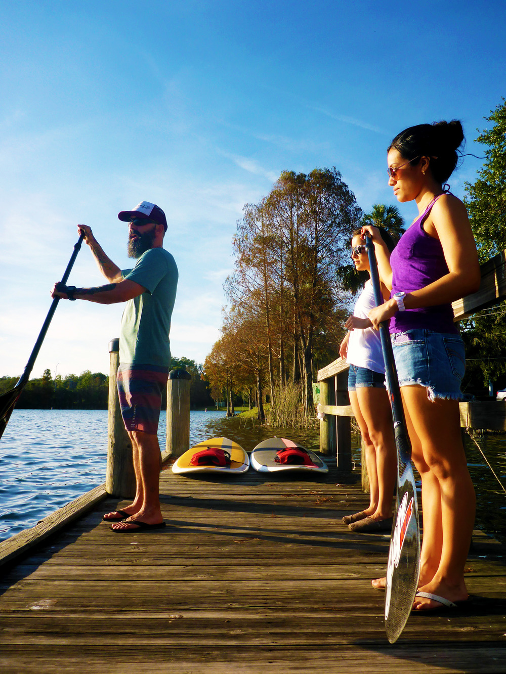 Locals preparing to  paddleboard Lake Ivanhoe in downtown Orlando