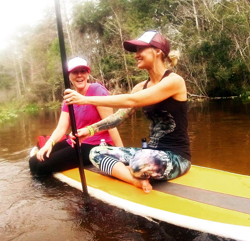 Group members relaxing on a paddleboard during our Wekiva River paddleboard tour