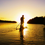Enjoying a sunset paddleboard rental in Orlando Florida