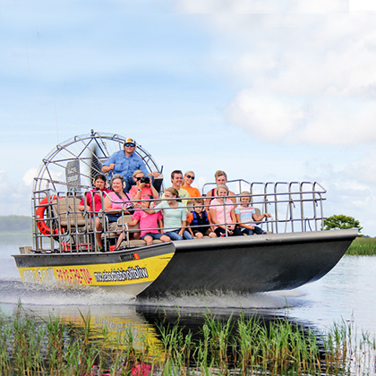 Airboat speeding across the swamp on Lake Cypress near Orlando Florida
