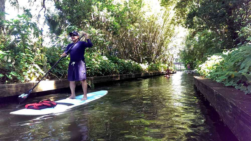 Paddleboarding-through-canal-in-winter-park.jpg