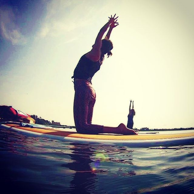 Don't forget  to get your afternoon stretch in today. #GetLocal #paddleboardyoga #getmoving