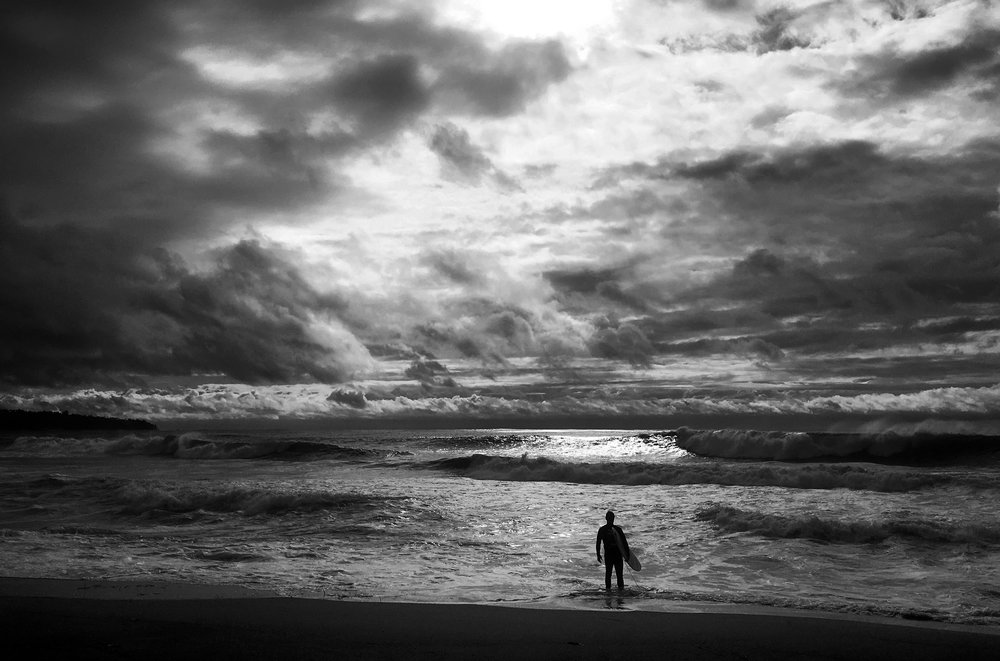 A man watches the surf after a summer storm in California.