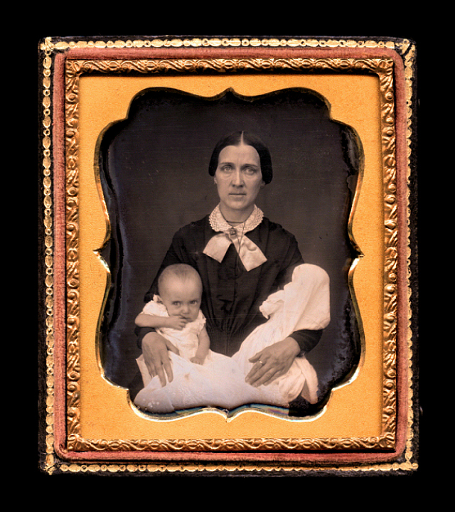 """The Twins"" (1852), sixth-plate daguerreotype, 3.75″ x 3.25,"" where a woman holds two infants, one living and the other dead (courtesy Thanatos Archive)"