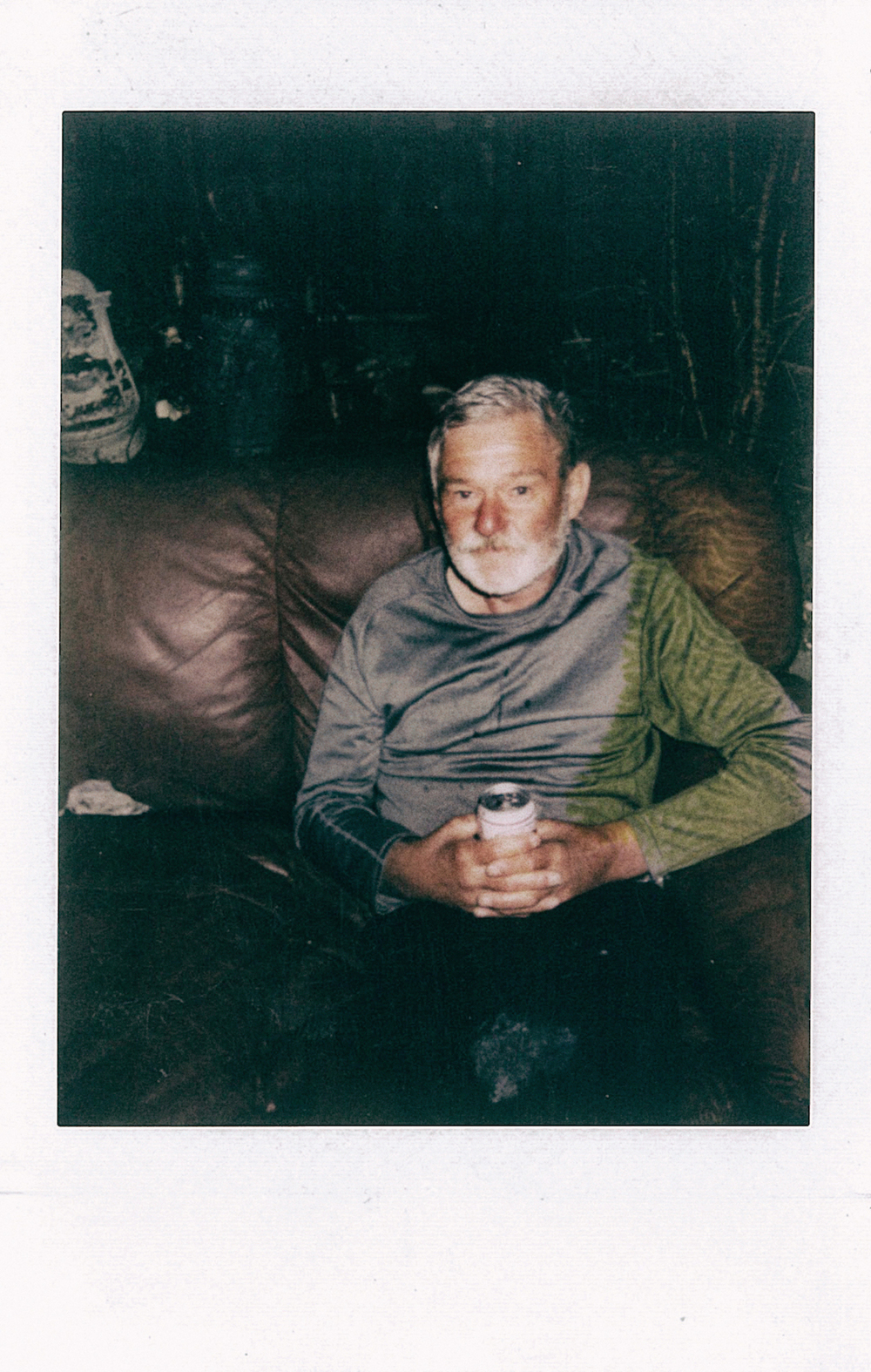 This is Richard. Drinking complications has lead to Richard being incontinent, meaning, he cannot hold in his drink. I gave him this polaroid, but found it a few days later in the couch with the yellow stain across his sleeve...someone had spilt their drink on it.