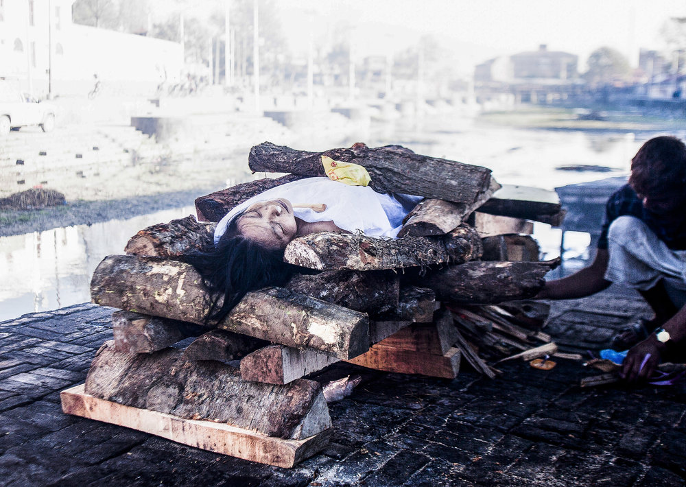 Death is believed to be contagious. For this reason Doms (a subcaste of the Untouchables) are the only caste allowed to touch dead bodies and perform cremations. Here a Dom prepares a wooden pyre for the cremation of a young woman at Pashupatinath's northern ghat.