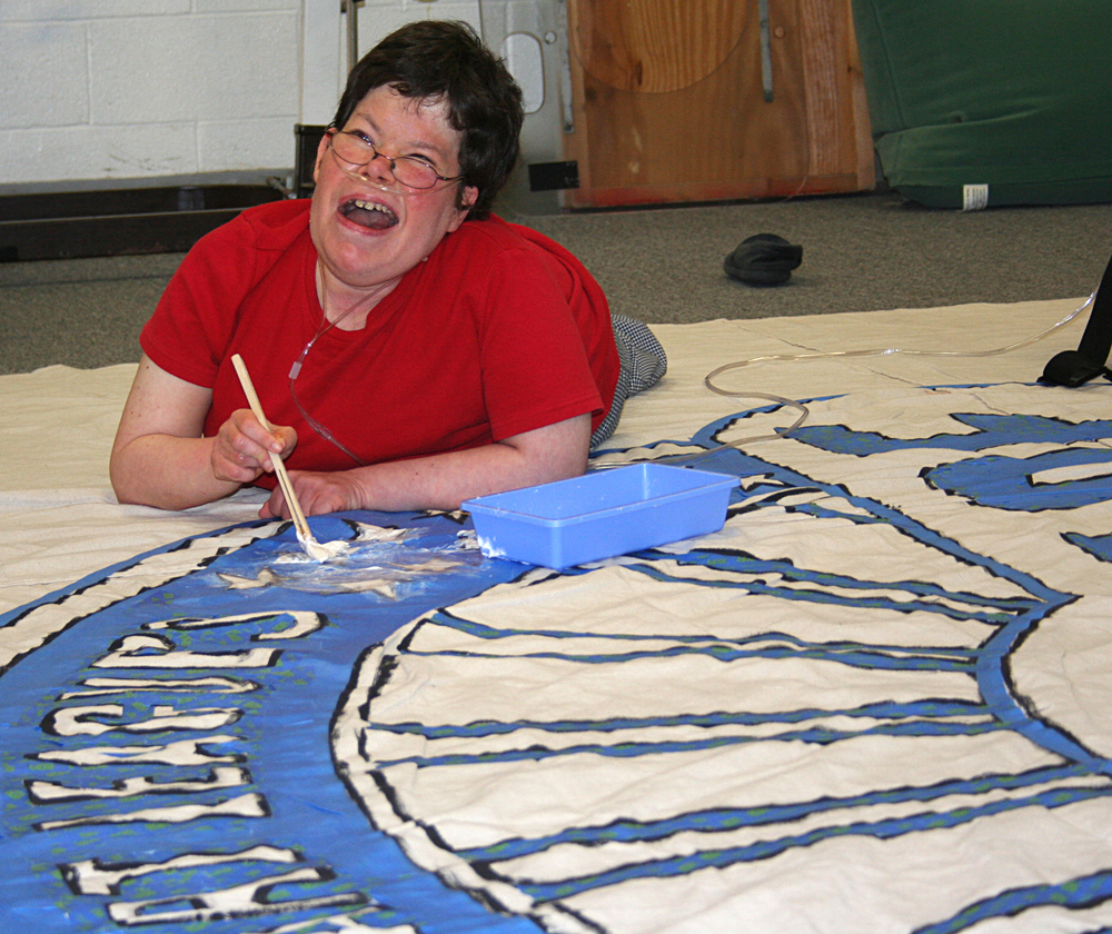 Jill is enjoying some time out of her wheelchair as she works on the Ohio Made logo.