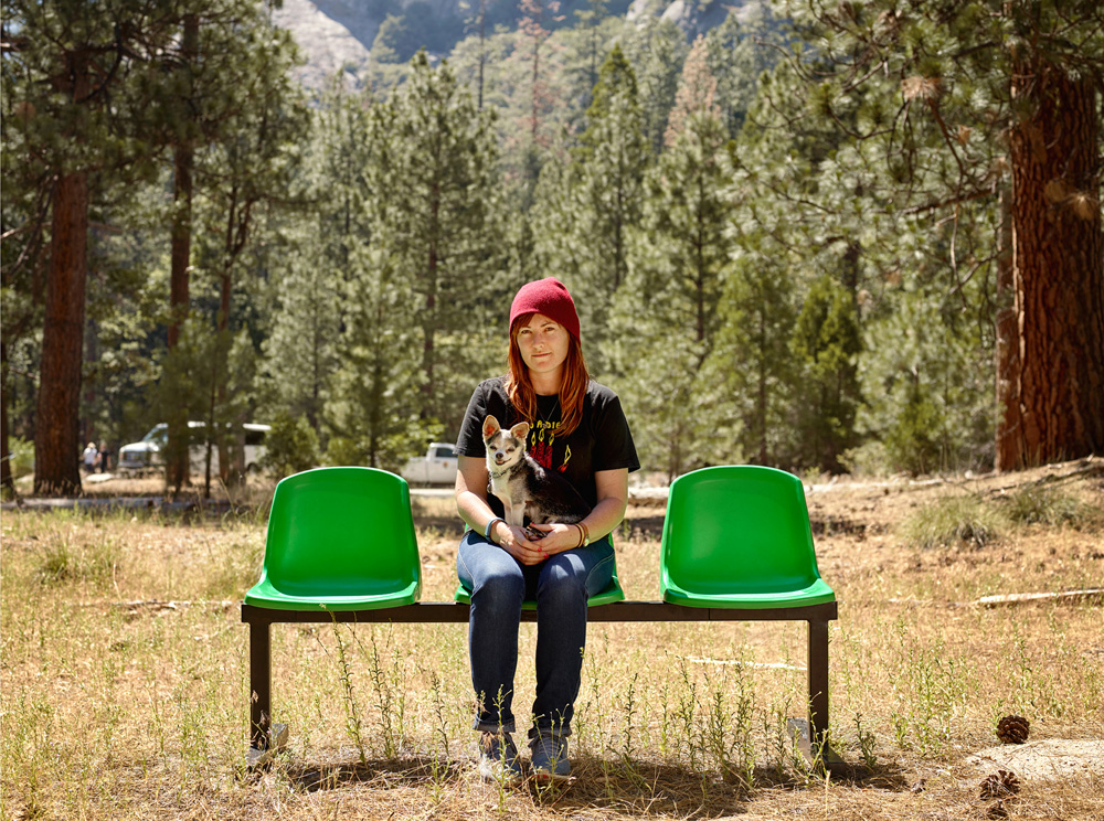 "Cassie Thistle, 29, Yosemite National Park, from the series 'Ages of Us' by Dylan Collard. ""Cassie was travelling with her family and we met her, her brother Luke and her mom at a picnic area just off the main road. Much friendlier than her Chawawa, Cassie told us about a childhood interest in horses that had turned into a respect / love for animals and a current job working with them."""