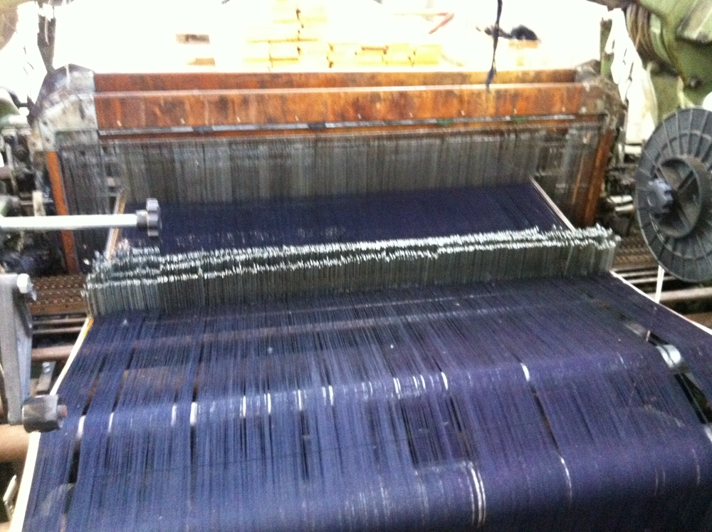 Indigo warp (with white selvedge) set up on beautiful vintage looms.