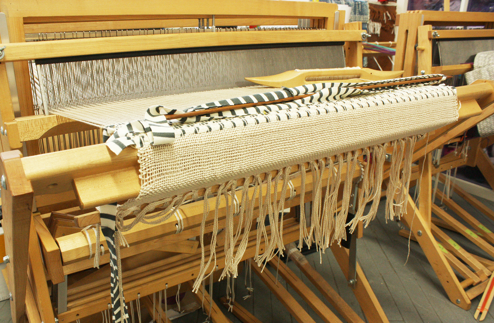 "Dressed loom, ready to start weaving with the scrap ""yarn""."