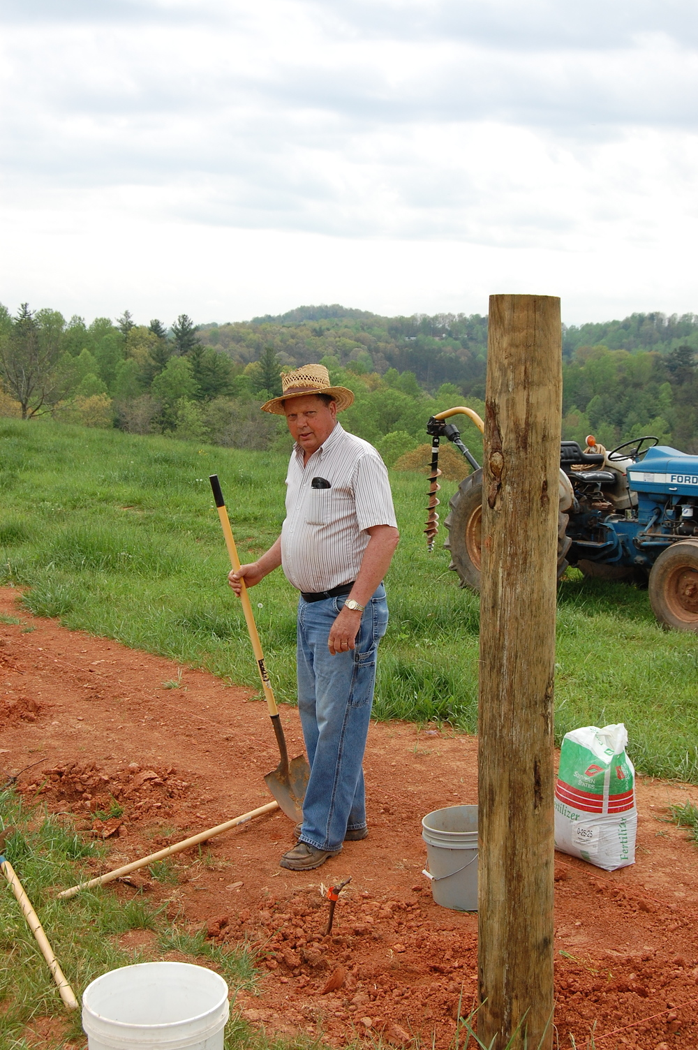 Pa Fris planting the first vine, 2009