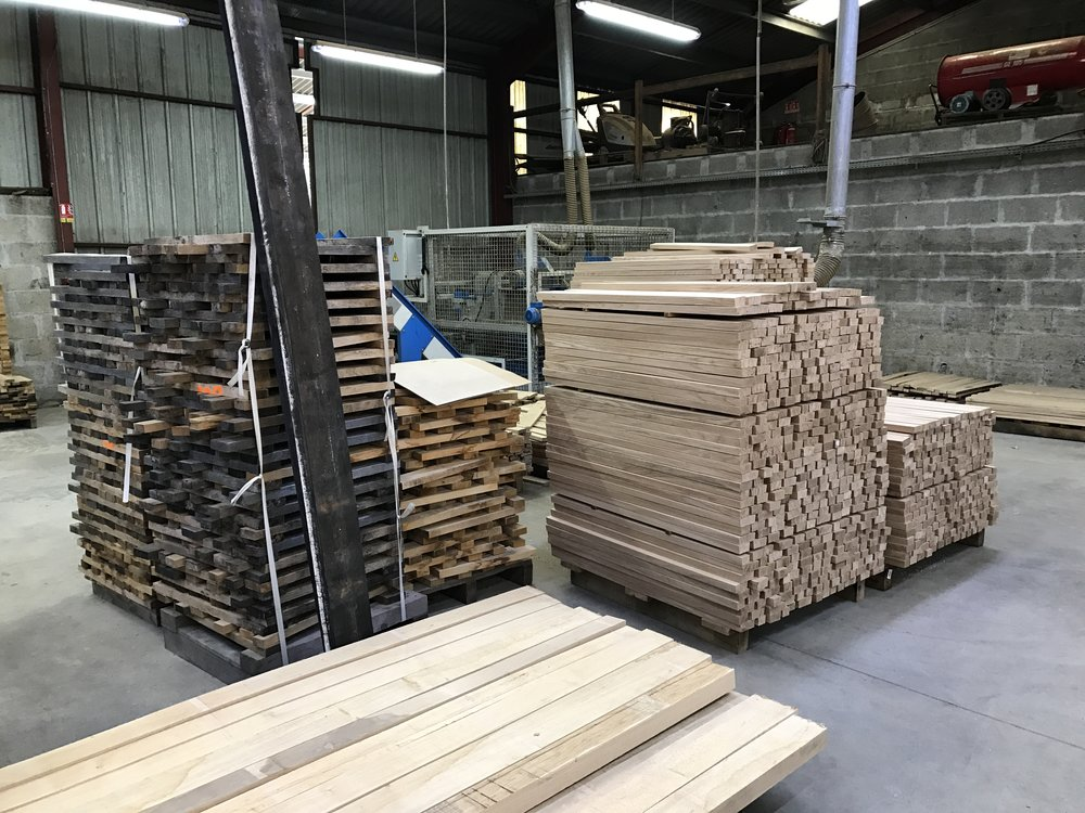 Stacks of milled oak at Tonnellerie Bossuet, waiting to be made into barrels