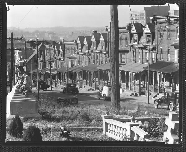 Evans' love of literature might have informed his photo work. - Two-Family Houses, From St. Michael's Graveyard, Bethlehem, Pennsylvania, Walker Evans, © Walker Evans Archive,The Metropolitan Museum of Art