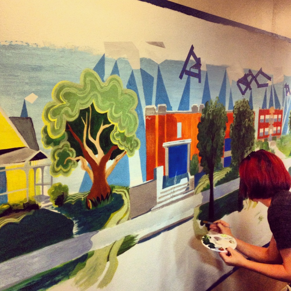 Jessica from the Brain Twins working on the SmallBox mural