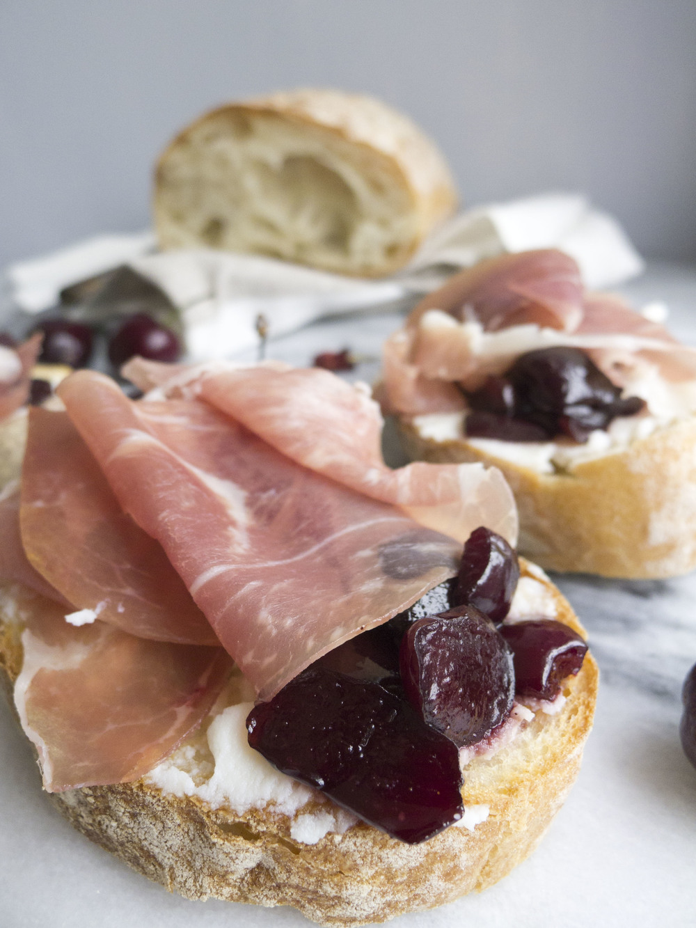 Cherry Sauce and Prosciutto Crostini