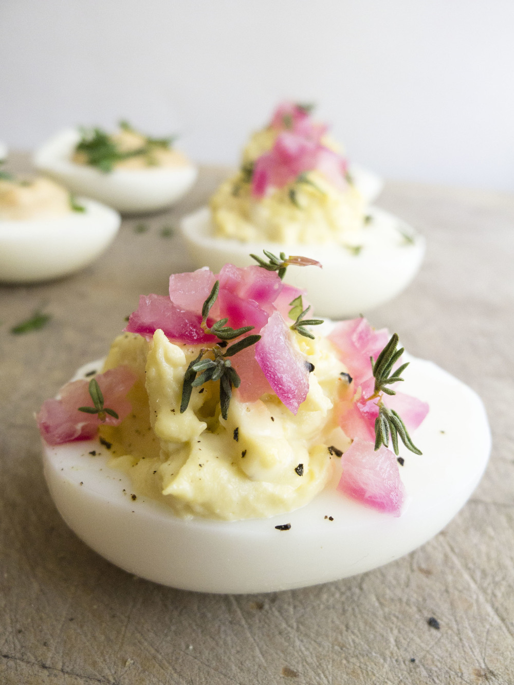 Deviled eggs 3 ways: with pickled red onions and thyme