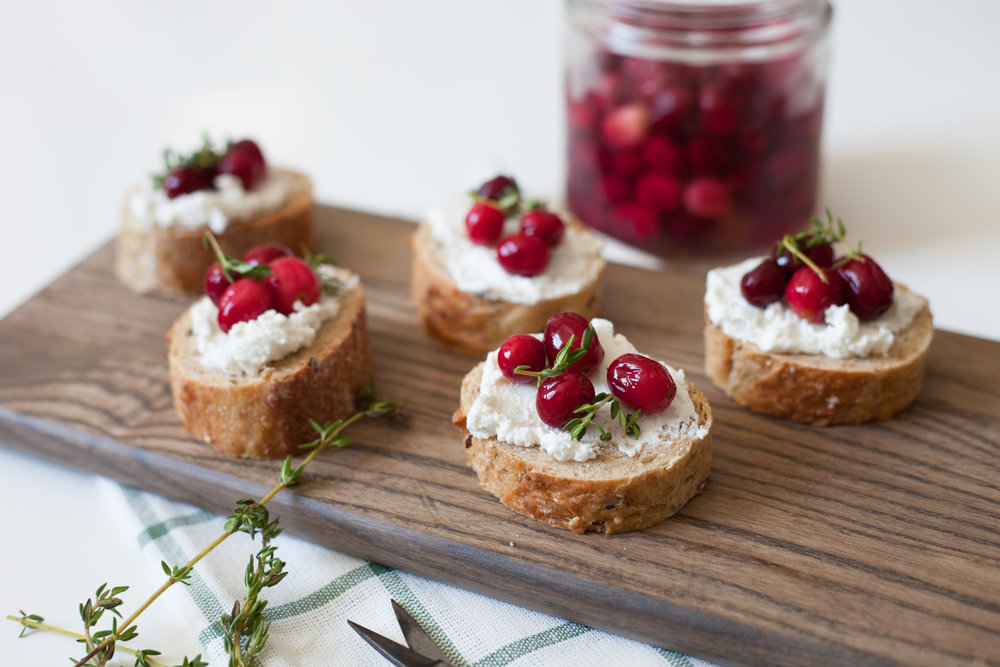 fresh cranberry entertaining guide- pickled cranberries on crostini