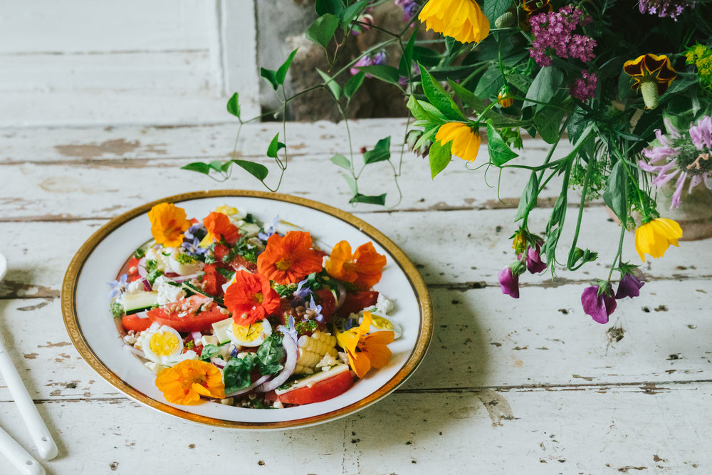 june tomato salad, herbs and country flowers: edible flowers