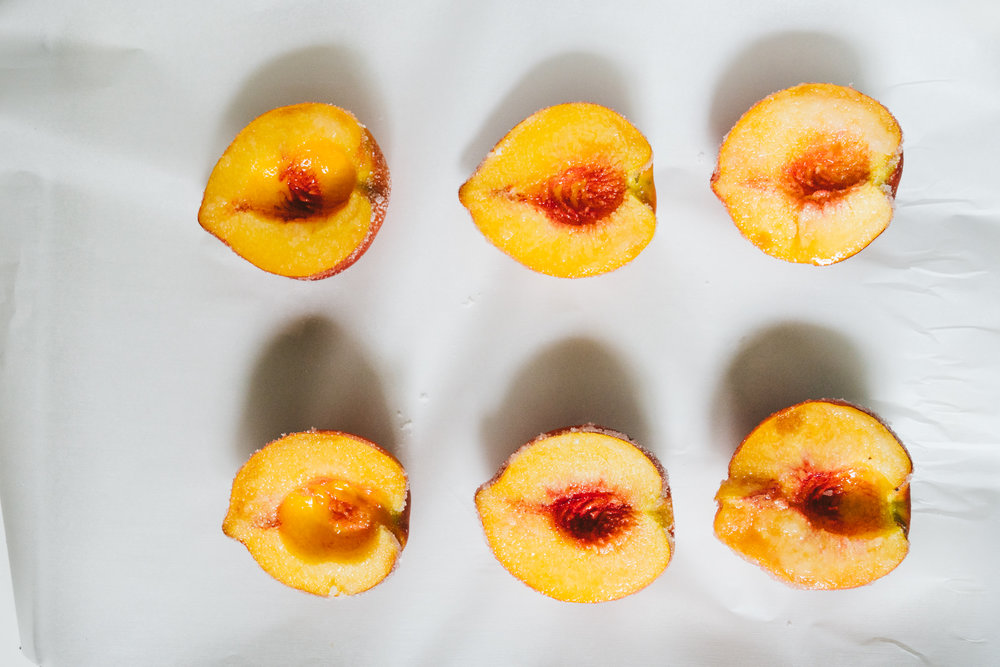 Broiled Peaches with Rum Whipped Cream