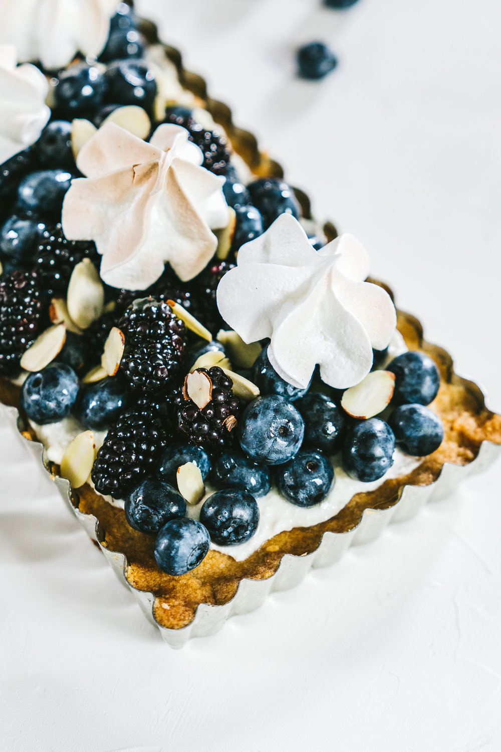 whole wheat almond berry tart with summer toasted meringue