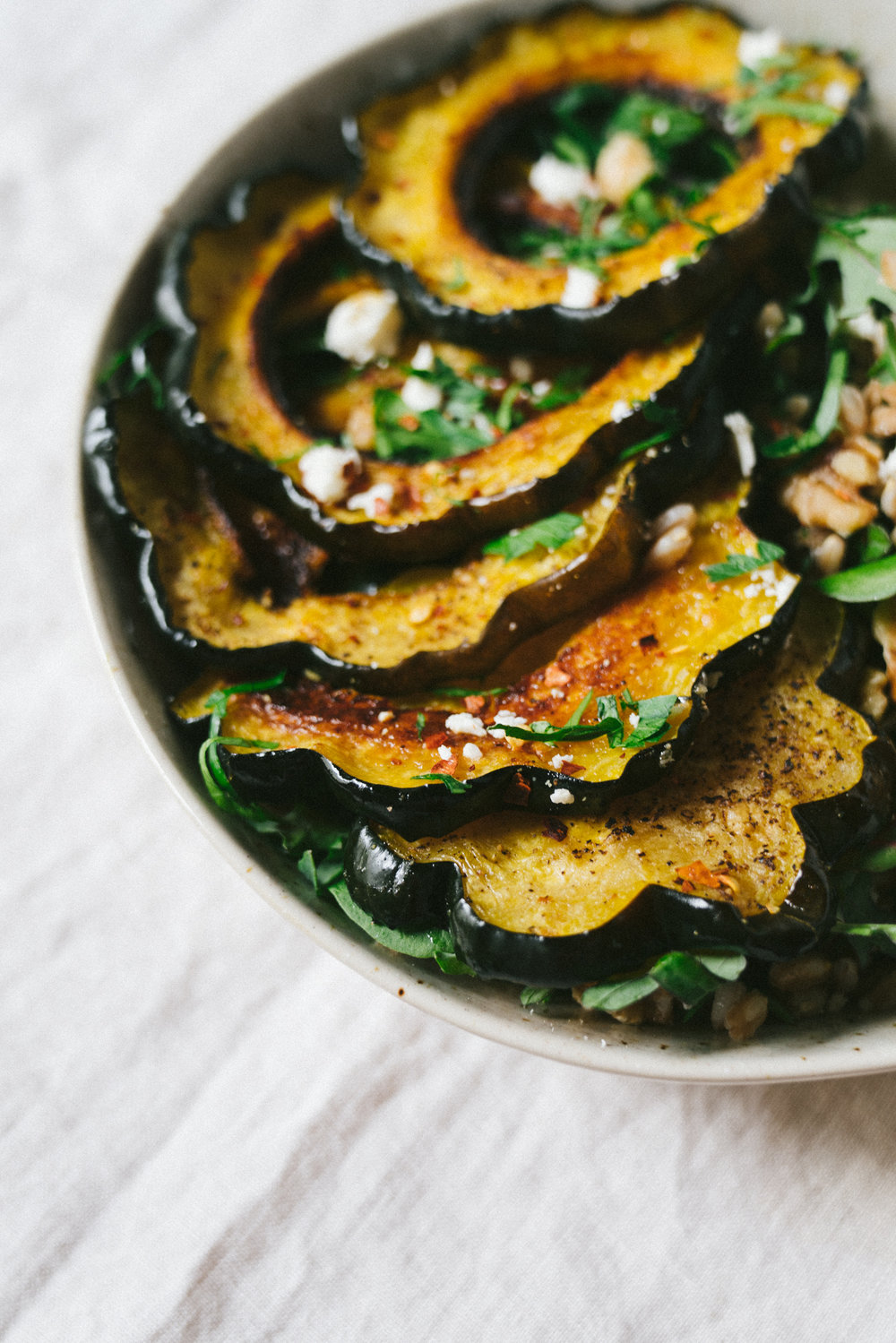 Roasted Acorn Squash Grains and Greens Salad with Feta