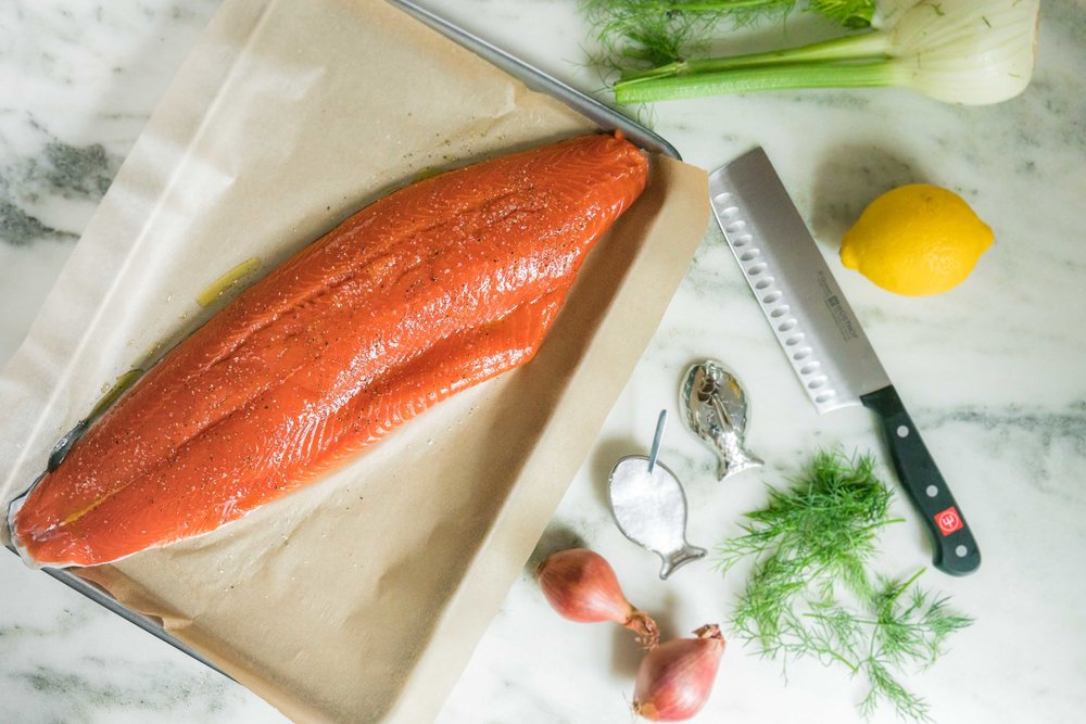shaved fennel and herb salad over salmon