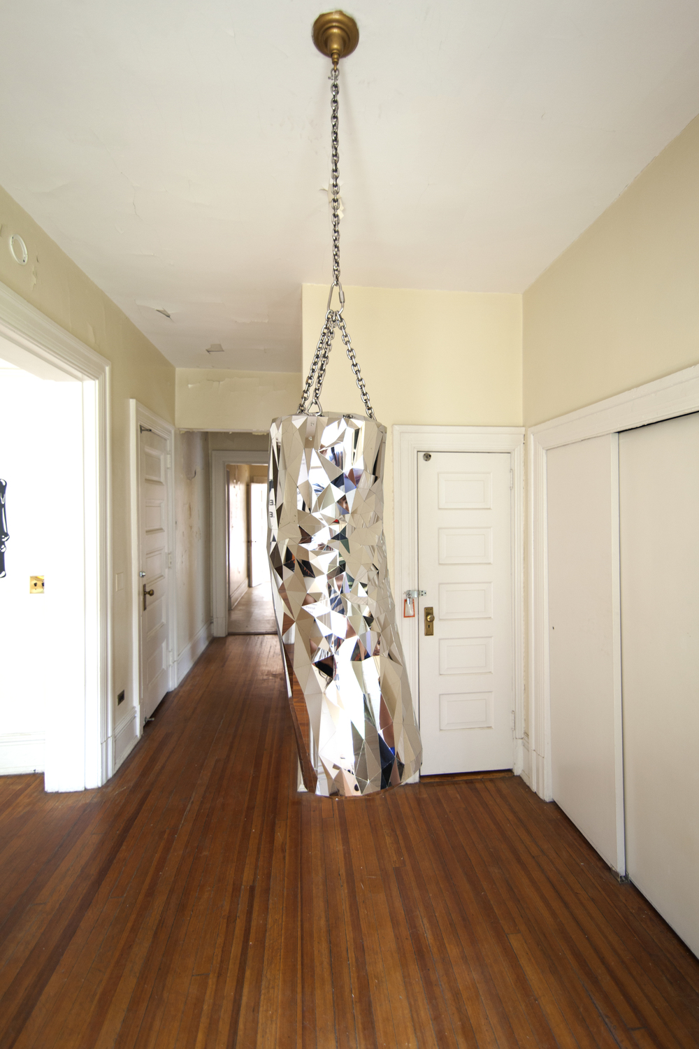 "Heavy Bag, 2015, Mirror polished stainless steel, 40"" tall (chain length variable) x 15"" diameter"