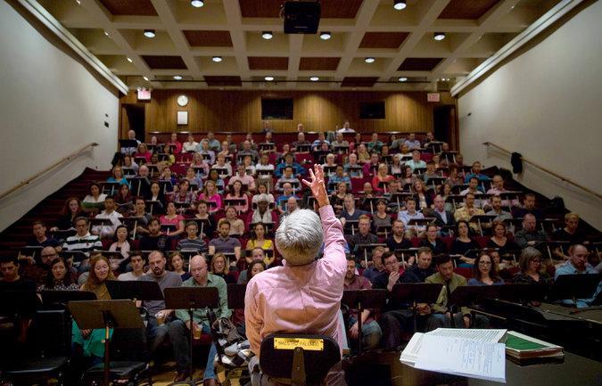 "Donald Palumbo, the Metropolitan Opera's chorus master, rehearsing about 150 chorus members for ""Die Meistersinger von Nürnberg.""       Credit Damon Winter/The New York Times"