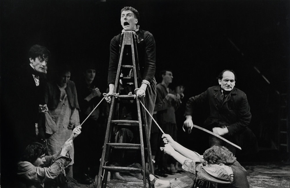 Nicholas Nickleby , RSC Aldwych, 1980 - Roger Rees as Nicholas, David Threlfall as Smike, Ben Kingsley as Squeers surrounded by Nicholas Gecks, Alan Gill, Mark Tandy & Ian East. Directed by Trevor Nunn  Photo Credit : Chris Davies