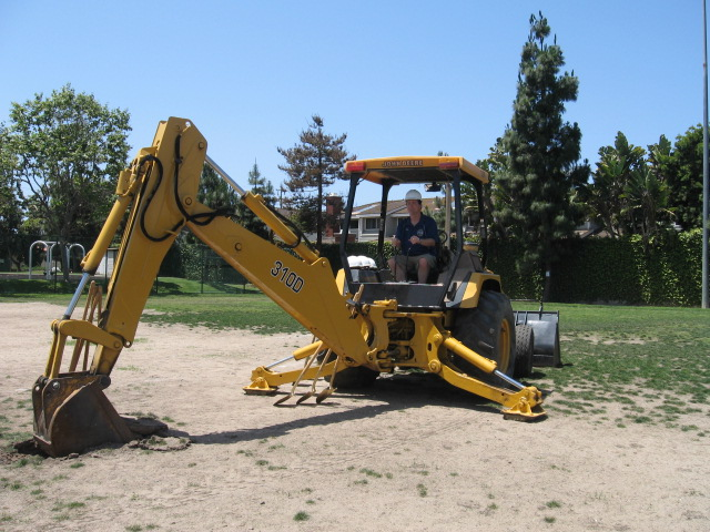 Fundraising chair Michael Hinz begins grading the field. May 18, 2013