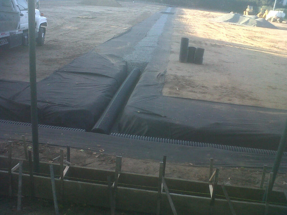 The drainage system has been installed before preparation of the turf surface.  June 30, 2013
