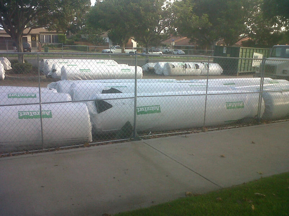 Astroturf fresh from the factory is staged for installation at Marine Ave Park. July 22, 2013